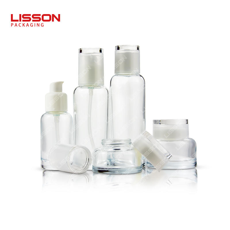 Wholesale pump glass cosmetic bottle and skin care cream jar set packaging